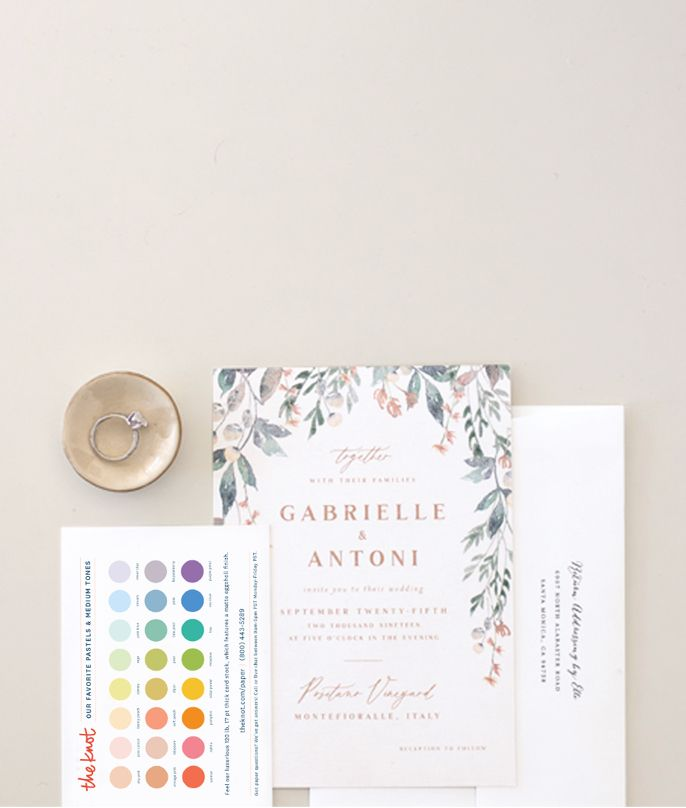 A sample wedding invitation bordered by florals, complementary envelope and color chart. Select to order free samples.