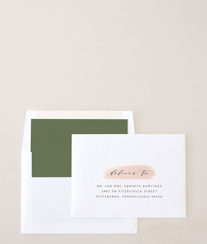 A custom printed envelope featuring a script font with guest details. Select to learn more.