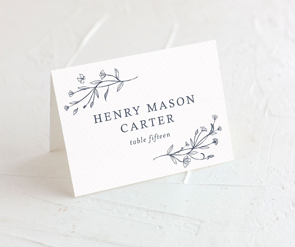 Natural Monogram wedding place cards closeup in blue