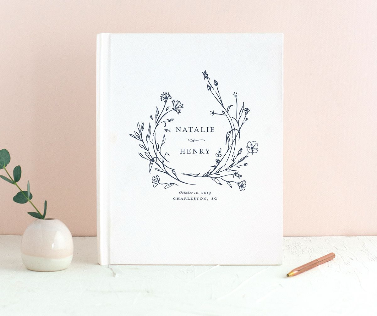 Natural Monogram wedding guest book in blue closeup