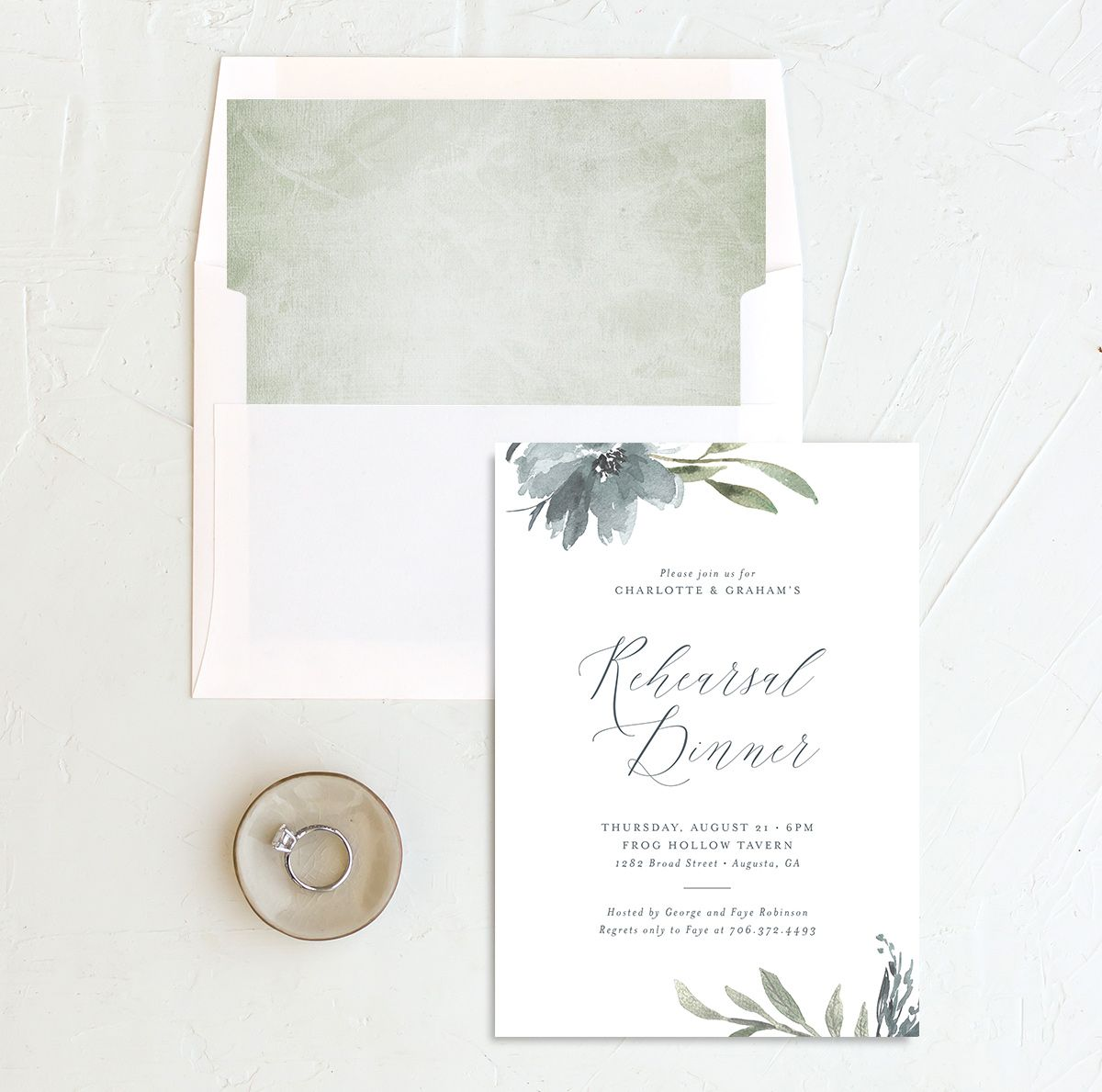 Muted floral rehearsal dinner invitation in dusty blue with envelope liner