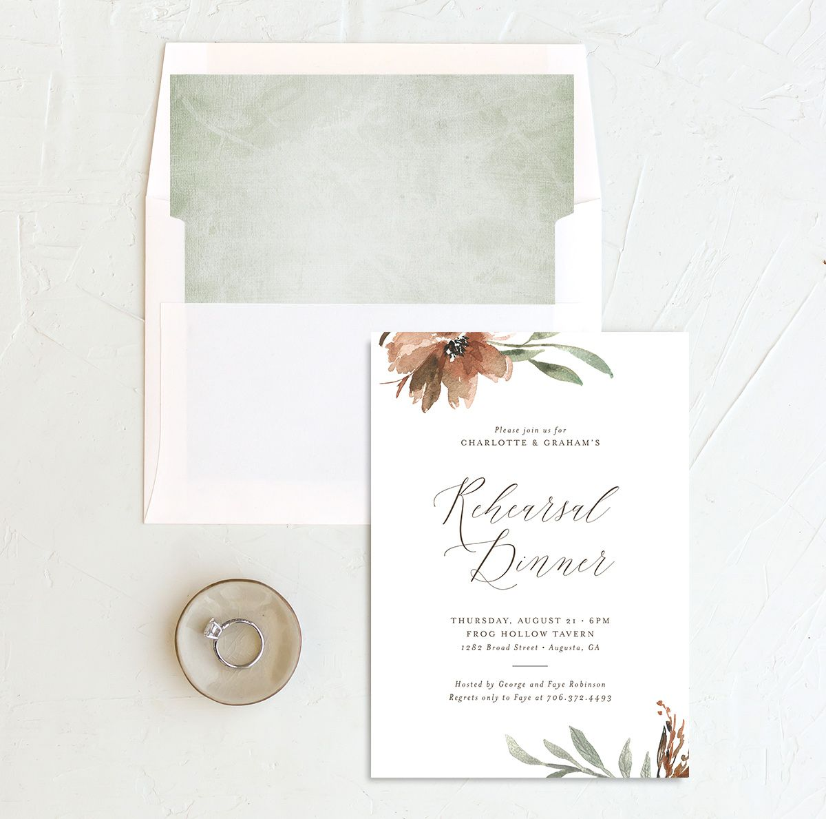 Muted floral rehearsal dinner invitations in copper with envelope liner