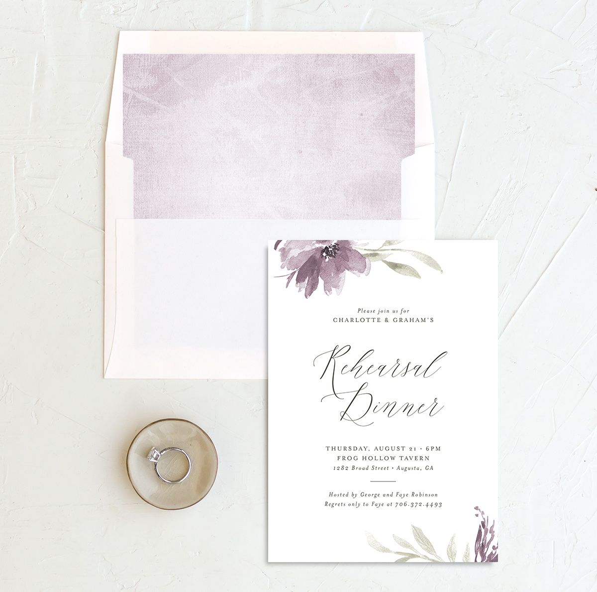Muted floral rehearsal dinner invitations in purple and envelope liners