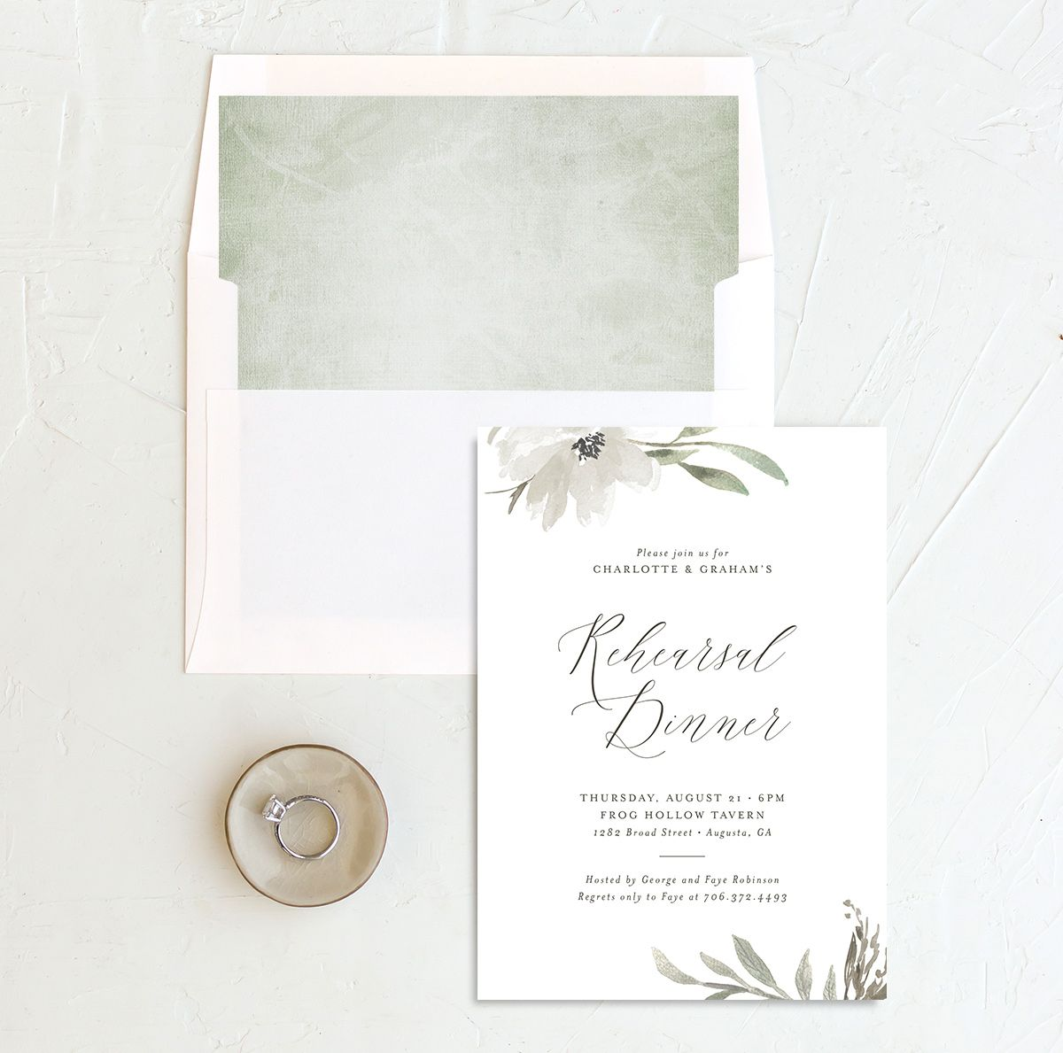 Muted floral rehearsal dinner invitations in white and envelope liner