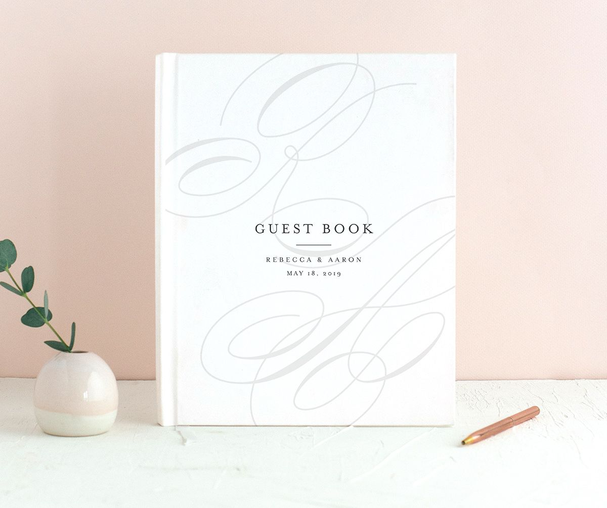 elegantly initialed wedding guest book