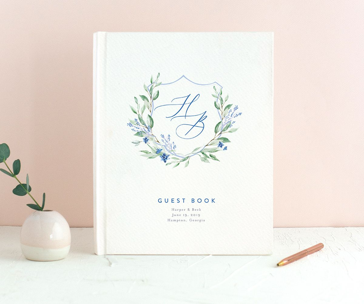 watercolor crest wedding guest book in blue