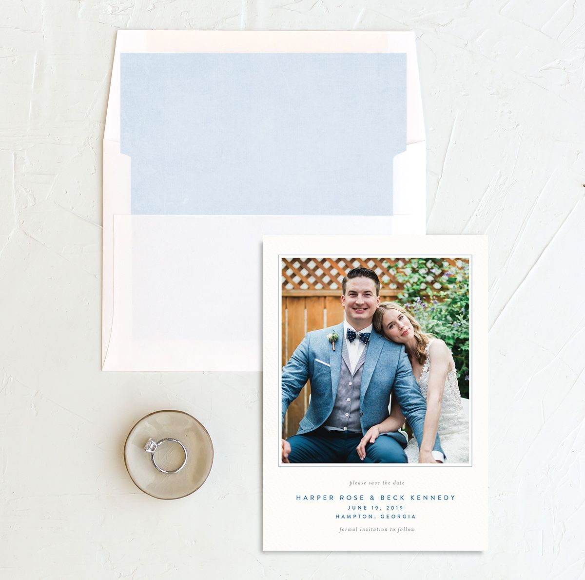watercolor crest save the dates in blue with envelope liner