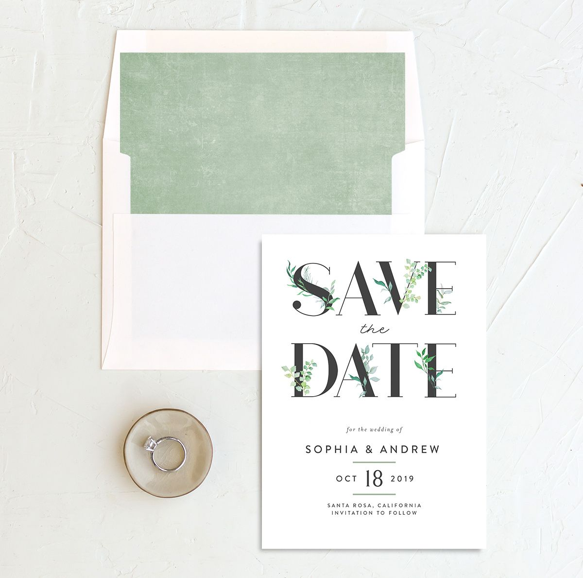 leafy ampersand save the date in green with envelope liner