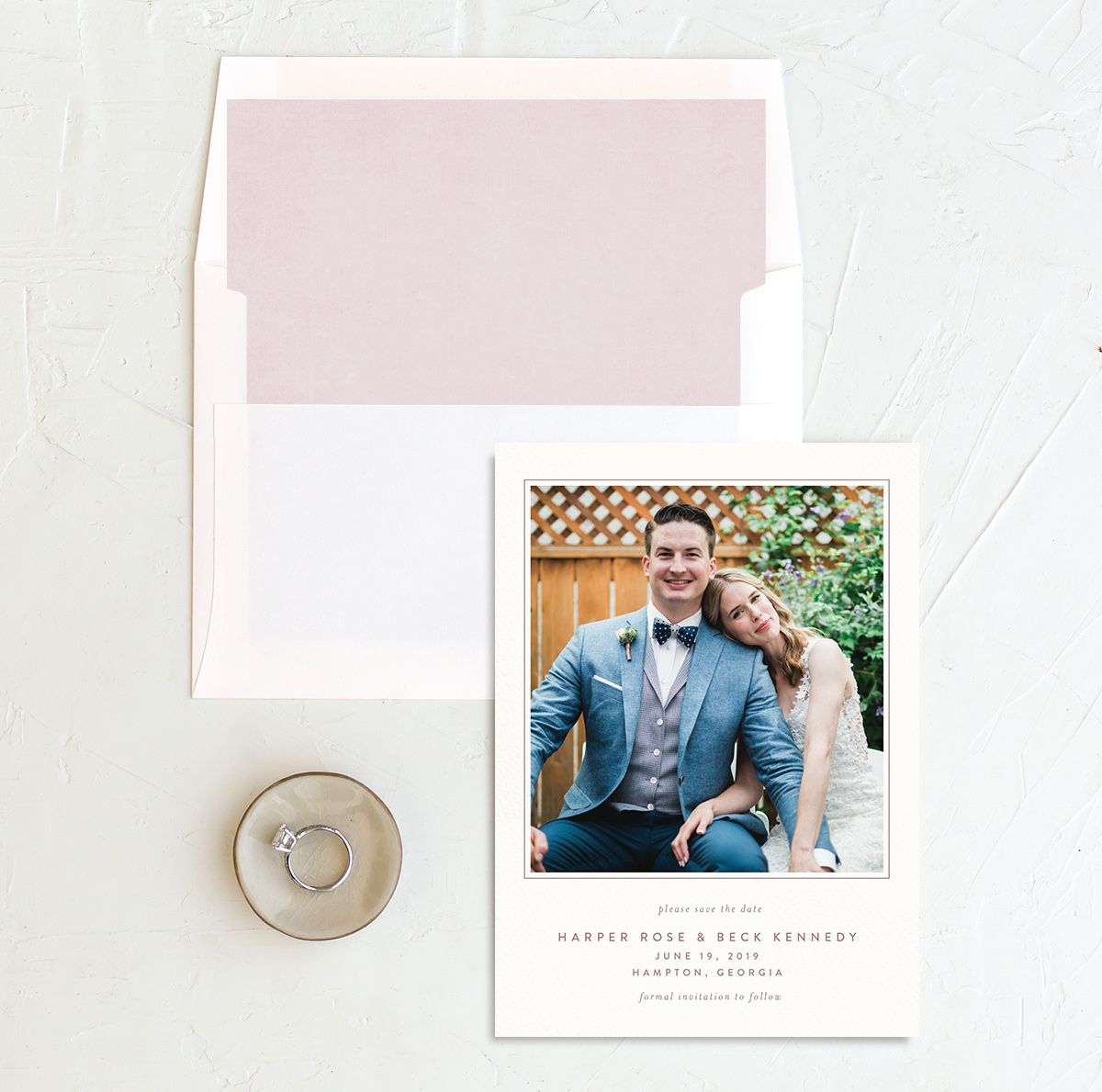 watercolor crest save the date cards in pink with envelope liner