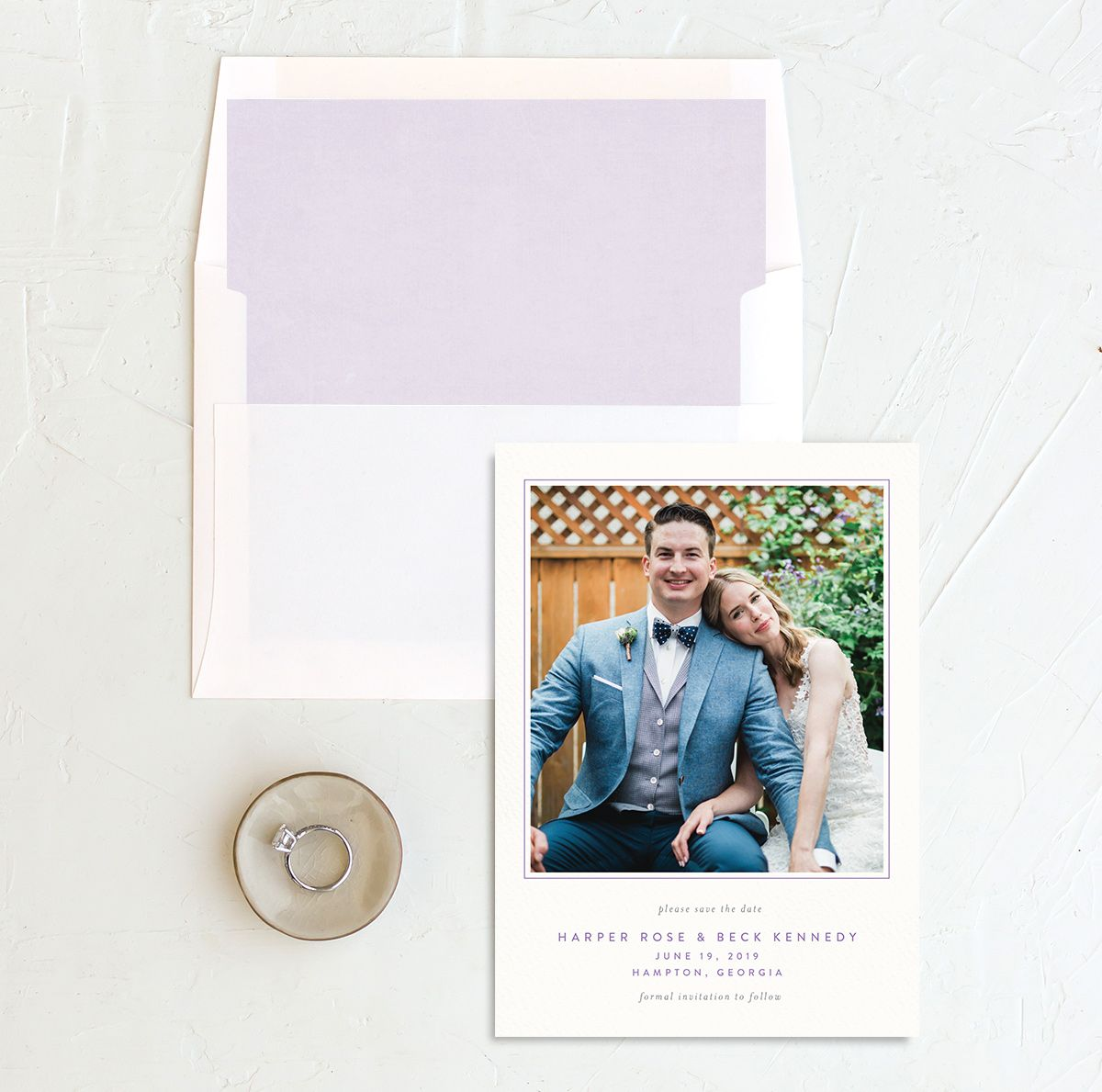 watercolor crest save the date cards in purple with envelope liner