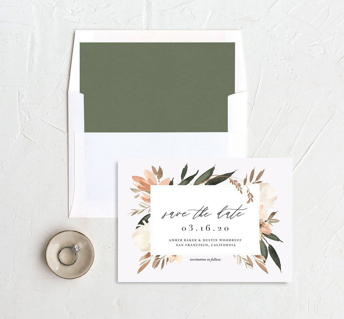 neutral greenery save the dates in orange with liner