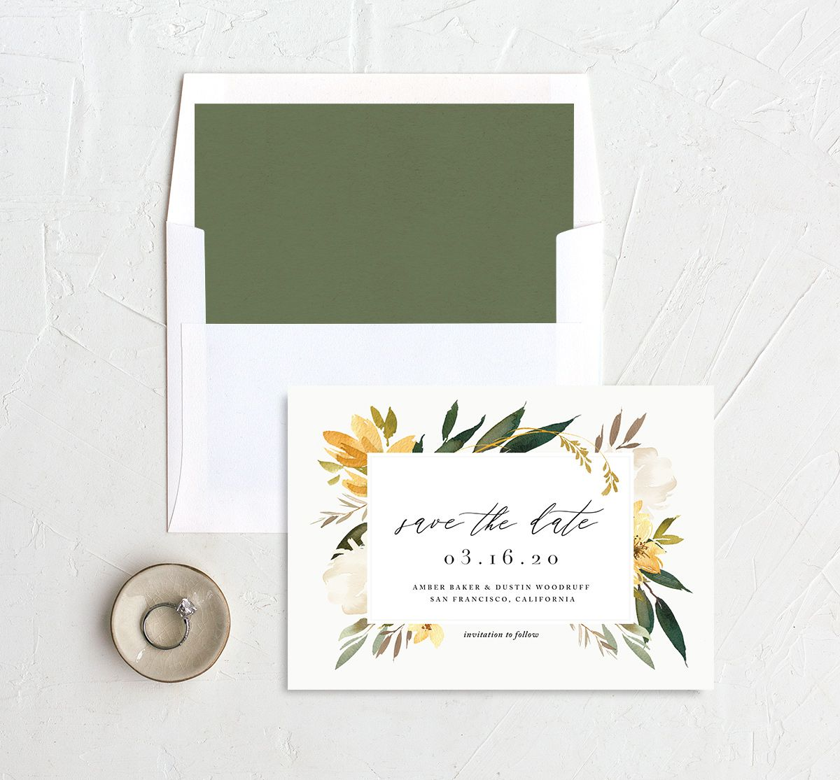 neutral greenery save the dates in yellow back