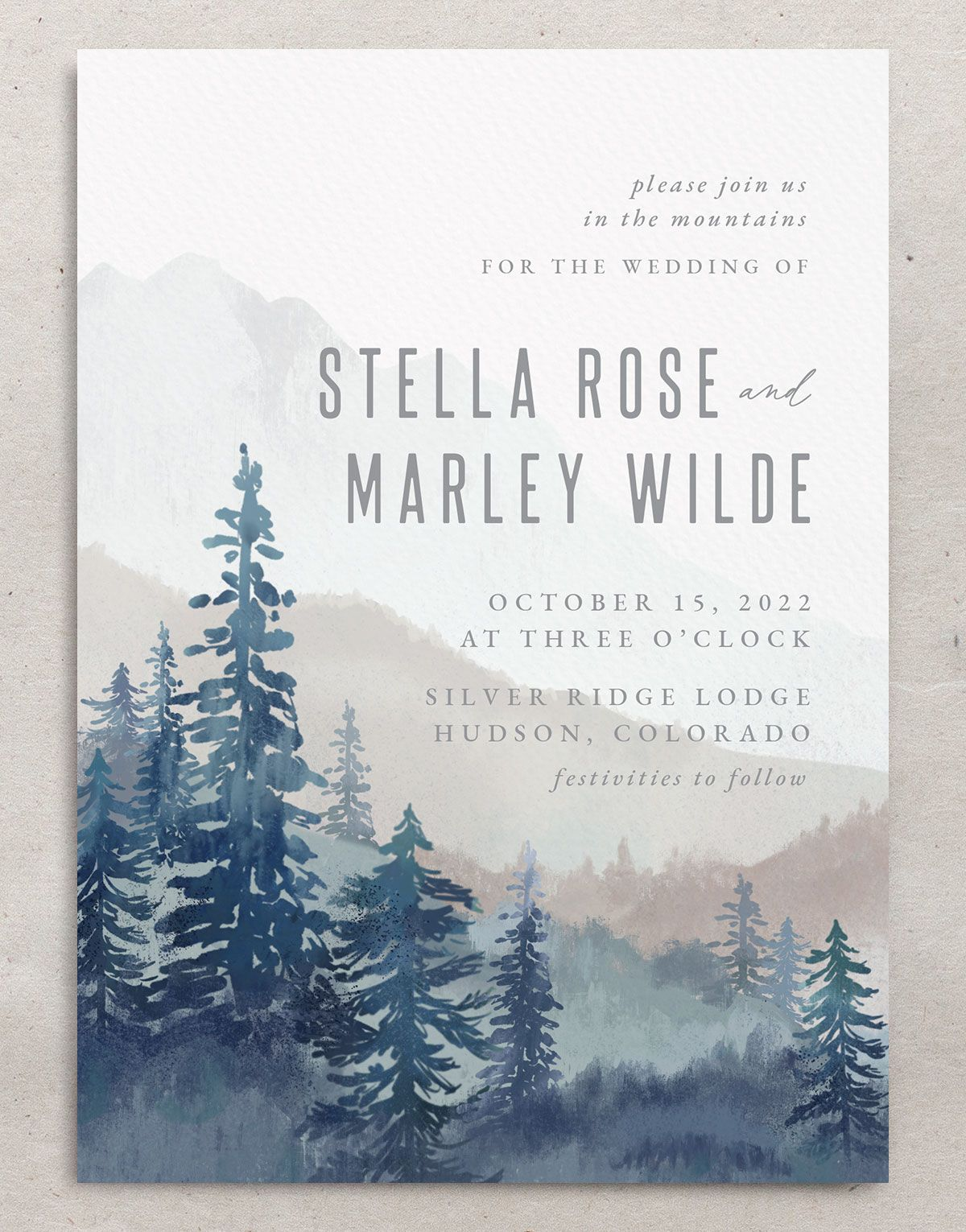 Painted Mountains wedding invite closeup in blue front