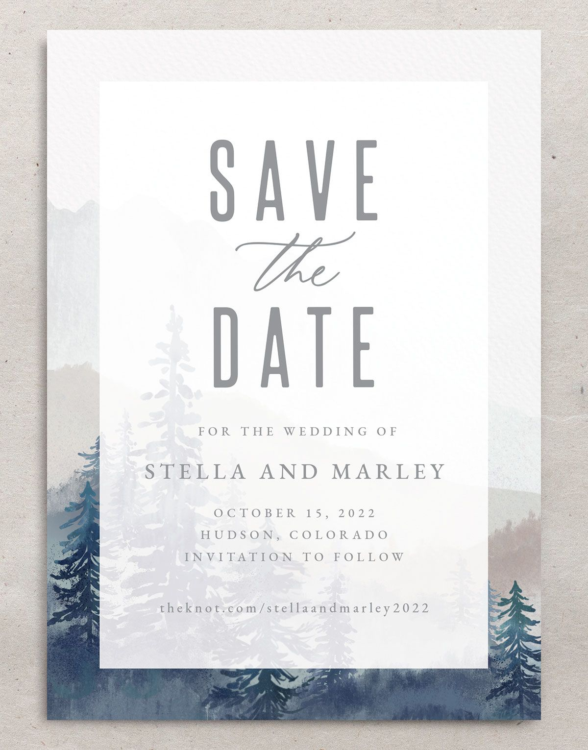 Painted Mountains save the date closeup in blue back