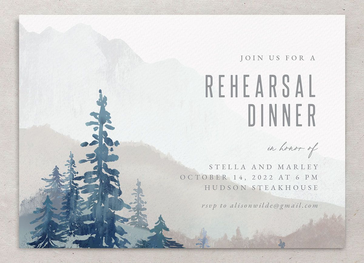 Painted mountains rehearsal dinner invitation front in blue