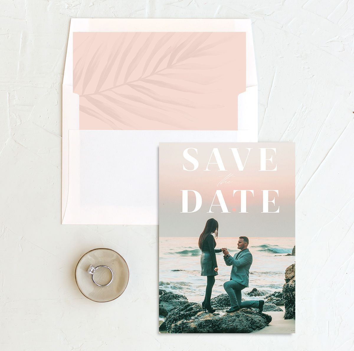 Mod Tropic save the date in pink shown with liner