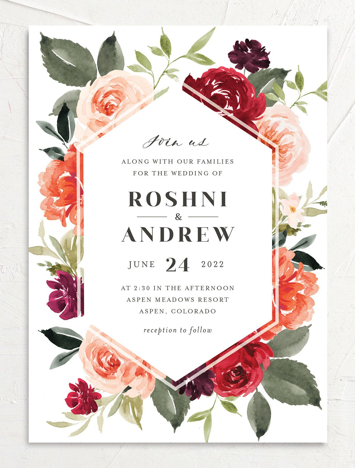 Vibrant Floral wedding invite closeup front in orange