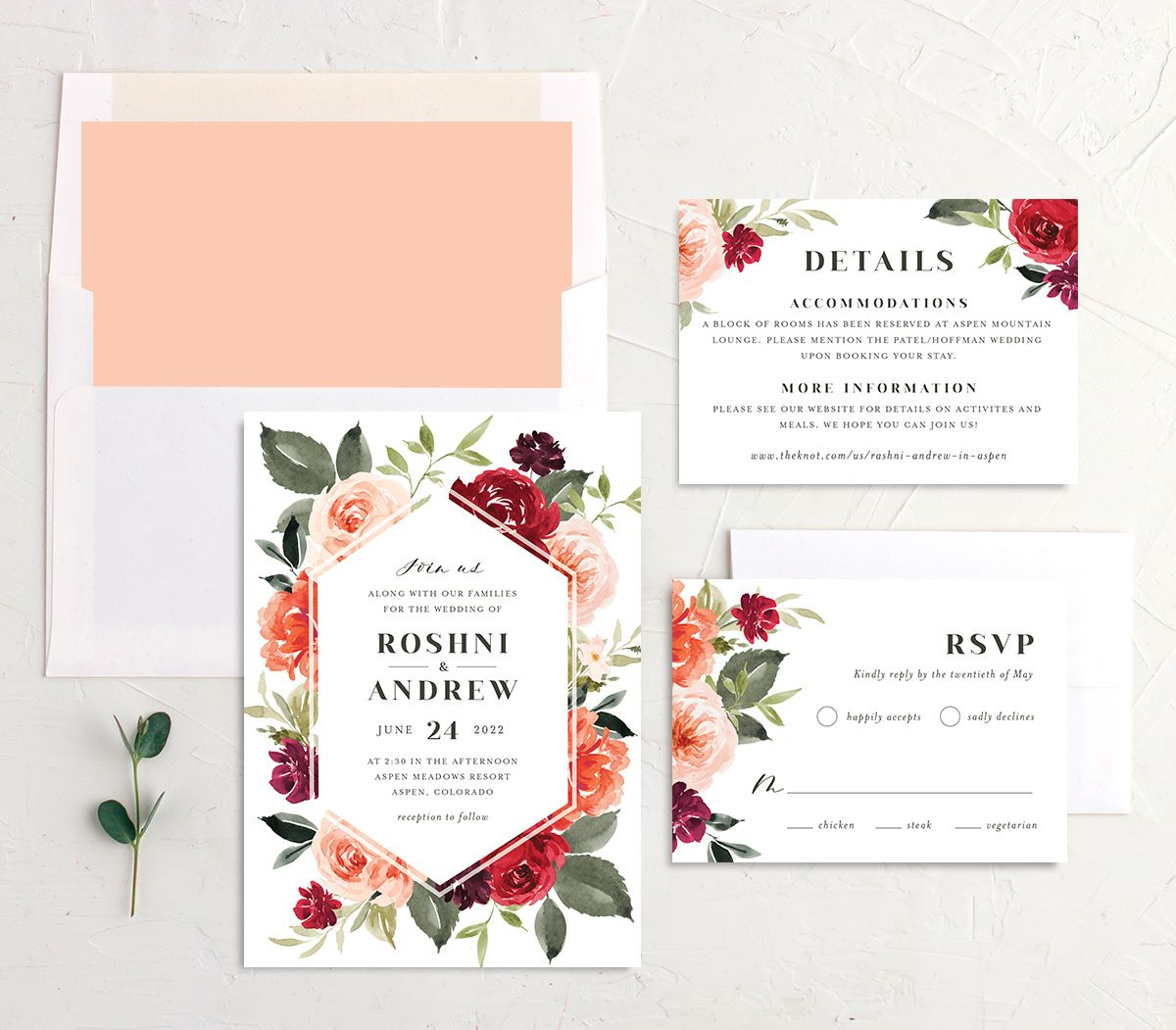 Vibrant Floral wedding invite suite shown in orange